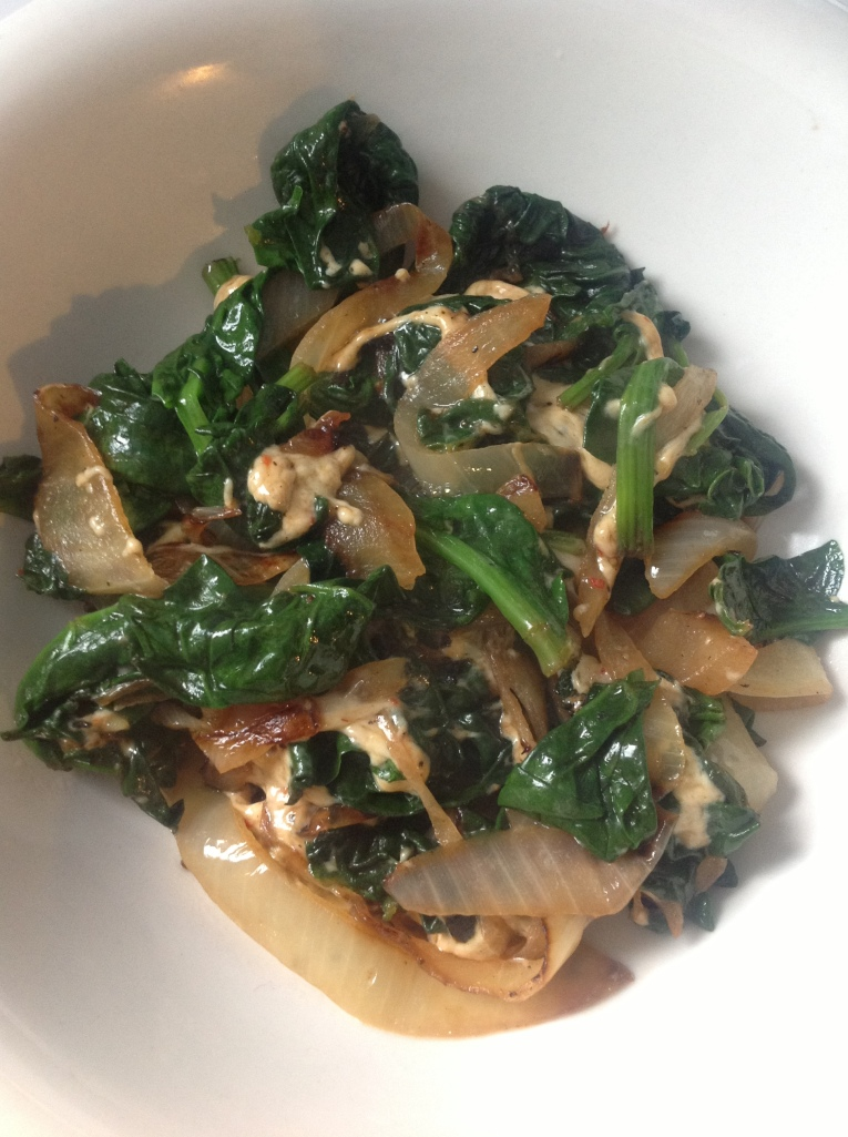 Sauteed spinach with garlic, grilled onions and vegan cheddar