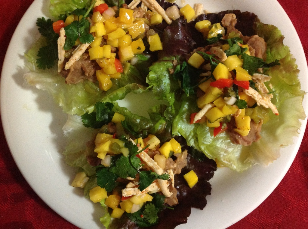 Burrito lettuce wraps with mango salsa, cilantro, vegan cheese and chiles